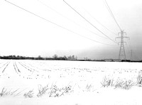 Indiana winter Power line and freight train.